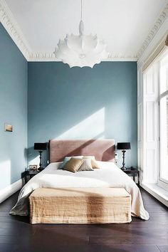 """We think it's so sad when a bedroom ceiling is left bare or has a ho-hum flush mount stuck up there,"" add the Massucco Warner Miller designers. ""Have fun with lighting in the bedroom! There is no..."