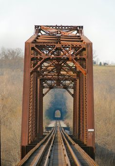 Railroad bridge Cotter Arkansas My granddad was an engineer on the White River Branch of the Missouri Pacific. My uncle was a Fireman and Brakeman, my Coffee uncles and dad worked for them briefly. Cotter became a town through the efforts of the railroad. I still like to hear the whistle and hear the rumble of the train as it moves through my town many miles away . My father and grandfather used to dive from the bridge when the water was deeper (before the dam),