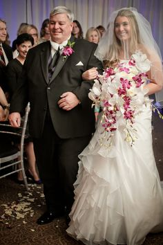 Kari & Paul | Wedding in Tampa Bay | Fuchsia,  Magenta and white orchid cascading bouquet. #andrealaynefloraldesign #tampaweddings #floridaaquarium