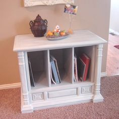 Make this cabinet on the cheap to hold cookbooks, photo albums, library books, and more. Find an old built-in TV at garage sale (or second-hand store) for next to nothing. Add the paint color you like and two dividers and it's done! Instructions are there.