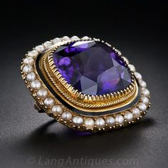 This modestly sized, but thoroughly lovely, high-quality adornment for your blouse or lapel features am entrancing, deep and radiant purple ...