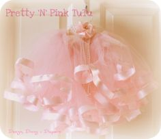 DIY tutu --I posted one that didn't have ribbon on it, but this one is AWESOME! I love it. I wonder if I could use the No-Sew with it instead. Probably not. I would love to make this!