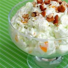 Pistachio Fluff Fruit Salad, instead of Ambrosia -   1 20 ounce cn crushed pineapple with juice -1 (3 ounce) package instant pistachio pudding mix   1 (12 ounce) container frozen whipped topping, thawed   2 large bananas, sliced   2 cups miniature marshmallows   1 (15.25 ounce) can fruit cocktail, drained   1 (11 ounce) can mandarin oranges, drained - Directions  Dump pudding into bowl. Add pineapple, and mix well. Mix topping bananas, marshmallows, fruit cocktail, and mandarin oranges.