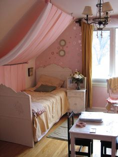 I love this idea since my girls share a bedroom w/slanted ceilings.