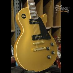 Gibson Les Paul Goldtop with Natural back, black P90s, black pick guard & gold hardware.