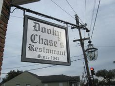 Dooky Chase  2301 Orleans Ave  Tue-Fri 11 am - 3 pm  arrive early for buffet  Leah Chase, 82 years old, hosts a cooking show devoted to Creole cooking, and she is the author of several cookbooks. She is known as the Queen of Creole Cuisine