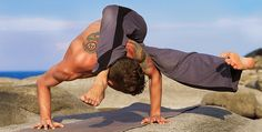 arm balance pose - tattoo man