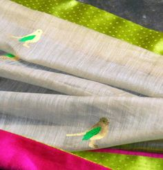 a rich woven texture with little chirpy birds this saree has a dramatic appeal