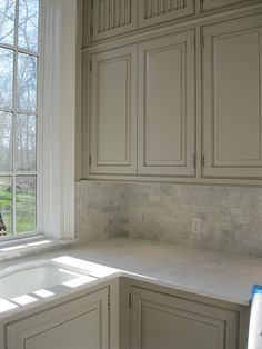 Backsplash white countertop gray cabinet