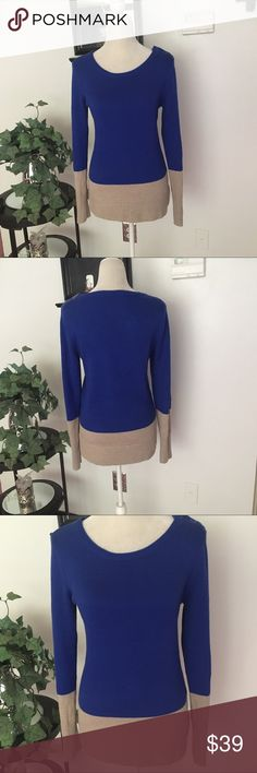 GAP Long Sleeve Blue Tan Color Block Sweater GAP Long Sleeve Blue Tan Color Block Sweater. Size Medium. In very good condition. Sleeves can be worn super long or rolled up. Blue/tan colors. Bust/chest measures approx 19 inches, length measures approx 27 inches. 55% nylon, 30% wool, 15% acrylic GAP Sweaters