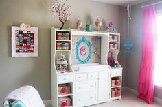 Love the changing table organization in this birds and blooms-themed nursery!