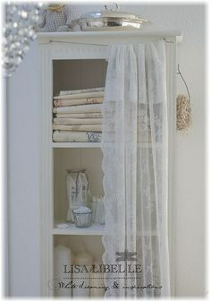 Could use the idea of pretty light & airy drapes in front of clothes storage/rails instead of doors.