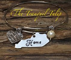 A personal favorite from my Etsy shop https://www.etsy.com/listing/517819355/kentucky-home-hand-stamped-wire-bangle