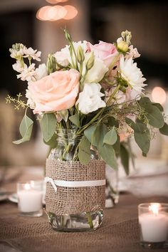 Mason jar flower arrangements in blush pink.                                                                                                                                                                                 More