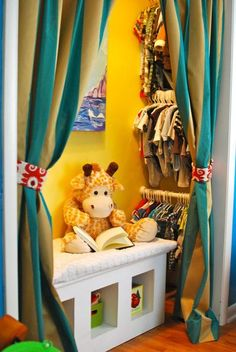 kids closet nook with striped curtains and bench for toy storage.  Kinds cute but useful for baby size clothing as well to get 3 rows