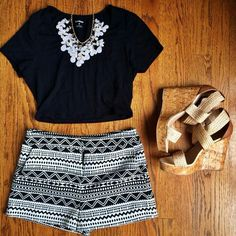 Patterned black & white shorts + black t-shirt + nude wedges