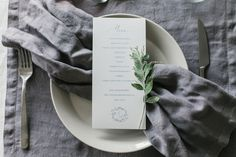 Wedding menu - part of the stationery with blue watercolor backdrop and handmade calligraphy.
