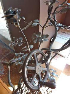 Sydney Lynch Jewelry - Hand-forged, hot-worked steel rose vine wrapped around old, found, rusted machinery. We visited Doug's 4,000 sq foot shop, and were amazed at his range of talent.