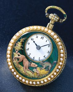 **THE BARKING DOG Piguet & Meylan A SMALL GOLD, ENAMEL AND PEARL QUARTER…