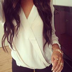 white blouse + dark curls.