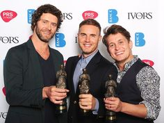 Take That collecting their 'Contribution to British Music' Ivor Novello award.