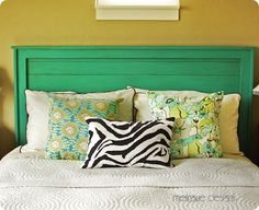 This wooden headboard project may look vintage, but it was actually built from scratch with inexpensive framing lumber,aged just enough for visual interest.