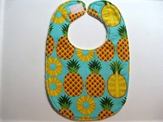 Title: HAWAIIAN PINEAPPLE.  Pattern placement may differ slightly, but made from same fabric.  My bibs have a layer of cotton batting for added absorbancy and body.        I love Minky fabric!  It is