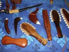 Ancient Hawaiian weapons--shark teeth embedded in wood