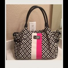 """Kate Spade Stevie Bag Signature spade print jacquard fabric with cowhide trim, top closure, white and pink stripe in front, double leather handle about 8 """" drop, leather bottom with embossed """"Kate Spade New York"""".   Interior: fully lined with script print fabric, zipped pocket, two slit pockets.  No dust bag.    PLEASE USE OFFER BUTTON FOR OFFERS!  😊 kate spade Bags"""