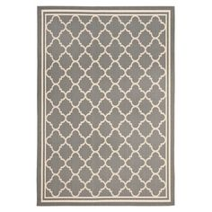 Enhance and beautify your patio, deck, or porch with this Courtyard Trellis Indoor/Outdoor Rug from Safavieh. Its quatrefoil trellis pattern has a matching border edge and is machine woven of polypropylene yarn in a sisal weave for added texture. Indoor Outdoor Area Rugs, Outdoor Decor, Indoor Pools, Outdoor Spaces, Thrifty Decor Chick, Patio Rugs, Trellis Pattern, Herefordshire, Quatrefoil