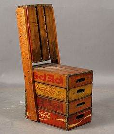 Soda crates = chair.  (via Anonymous Works: Soda Chair)  More crate repurposing here.