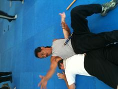 Armbar and takedown to an elbow to the back of the head.