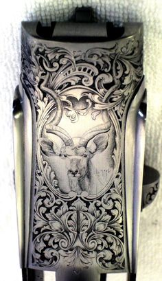 The Gun Art of Master Engraver Lee Griffiths | Field & Stream  He put a kudu on the bottom of the receiver.  Note the horns intertwining with the scrollwork!