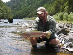 Andrew Schuster admires another beautiful New Zealand Rainbow trout.