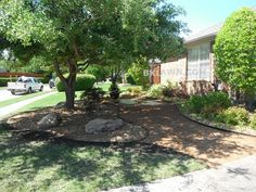 Decomposed Granite and plant bed reduce turf in hard to maintain area