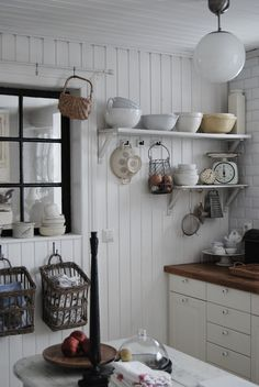 I love the wooden walls but the look needs a few pops of colour to soften it.