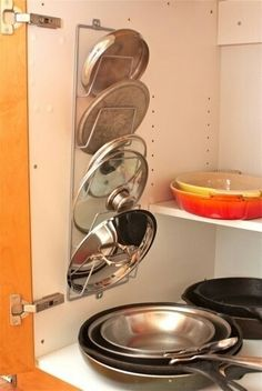 Kitchen organization. I so need this for my pot/pan lids that always seem to be in my way!