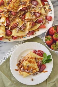 Dulce de Leche Crepes~ Sounds Fancy, but easy to make! Crepes made in your  fry pan  and Top with sweet and chunky strawberry pieces, chopped pecans and a drizzle of dulce de leche or cajeta,.