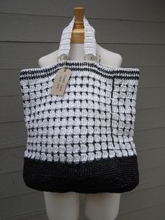 Handmade reusable grocery bag, hand crocheted bag, raffia bag, large tote, black and white by BacktoBasicsbyYGG on Etsy https://www.etsy.com/listing/93868607/handmade-reusable-grocery-bag-hand