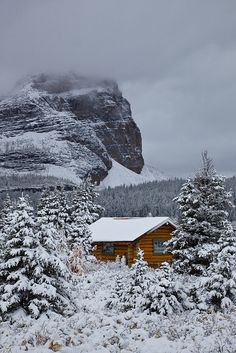 Cabin of Mount Assiniboine Lodge after Snowfall    Sunburst Peak and subalpine forest with a cabin of Mount Assiniboine Lodge after an autumn snowstorm; Mount Assiniboine Provincial Park, British Columbia, Canada, Mount_Assiniboine_Lodge-45