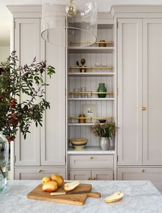 Cheap Home Decor Light grey cabinetry + warm toned kitchen + open shelving + glassware shelving + marble countertop + glass semi-flush fixture Home Decor Kitchen, New Kitchen, Home Kitchens, Kitchen Dining, Kitchen Ideas, Kitchen Layout, Kitchen Modern, Minimal Kitchen, Awesome Kitchen