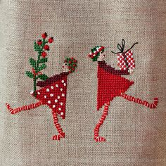 Sweet Christmas cross stitch with shoppers and their haul of a present and a tree