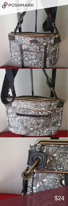 **On Sale** The Sakroots Artist Circle Small Xbody Exterior: Coated canvas, Trim: Polyurethane Interior: Polyester Antique brass tone Front slit pocket, Back Zipper pocket, Main zipper closure Lining features two open multi use pockets and a zippered back wall pocket. ***One rivet comes loose. Shown in 3rd photo*** The Sak Bags Crossbody Bags