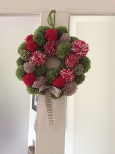 A hand made Christmas wreath using a variety of mixed coloured pom-poms