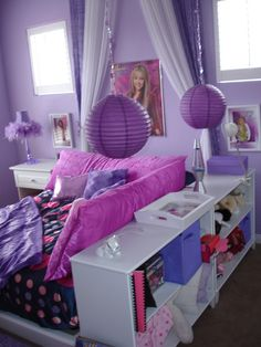 Tween room, This is a chic purple tween room.  The bed is surrounded by pillows for girl talk.  Hannah Montana is used as accent.  The idea for the room came from PBTeen however my bed and shelves on the side are from Target.  Hanging lights are from lunabazaar.com.  Artwork is from allposters.com.  Side table lamp is from JCPenny.com., Girls Rooms Design