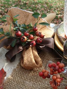 Beautiful napkin fold and fresh berries/greens for your Fall table.