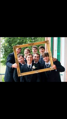 Funny picture of groomsmen acting like the bridesmaids