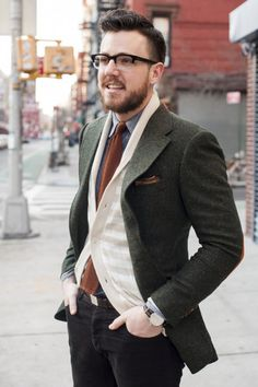 Green tweed blazer, neutral cardigan, knit tie, chambray shirt, black denim, and tan suede wingtips