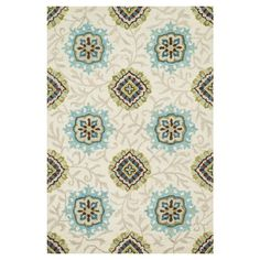 Anchor your living room seating group or define space in the den with this artfully hand-hooked wool rug, showcasing an exotic medallion motif for eye-catchi...