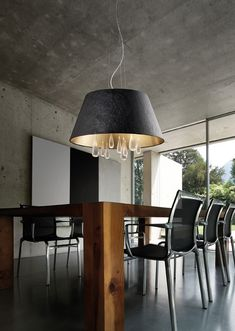 "Tears SO60 pendant lamp by Evi Style, design by Stefano Mandruzzato. Behind each tear there is a a story. Behind the collection Tears there is a story of continuous search for technical and aesthetic  excellence, aimed at the creation of design objects that illuminate the elegance and prestige of the most refined furniture: in a word, the Evi Style history. The blown glass ""rigadin"", the contrast between the wrinkled eco-leather outside and the inside metalized, the chrome and gold 24kt…"